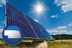 nebraska map icon and solar energy panels with photovoltaic cells